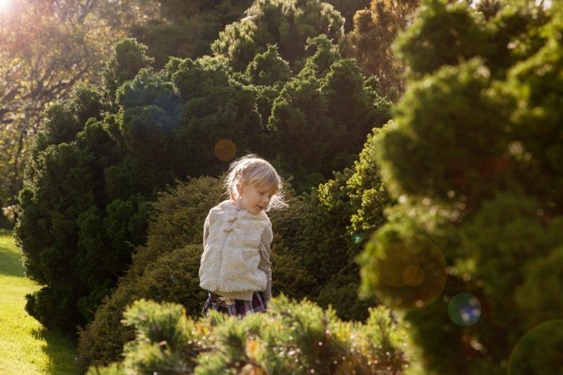 Young girl standing backlit by sun