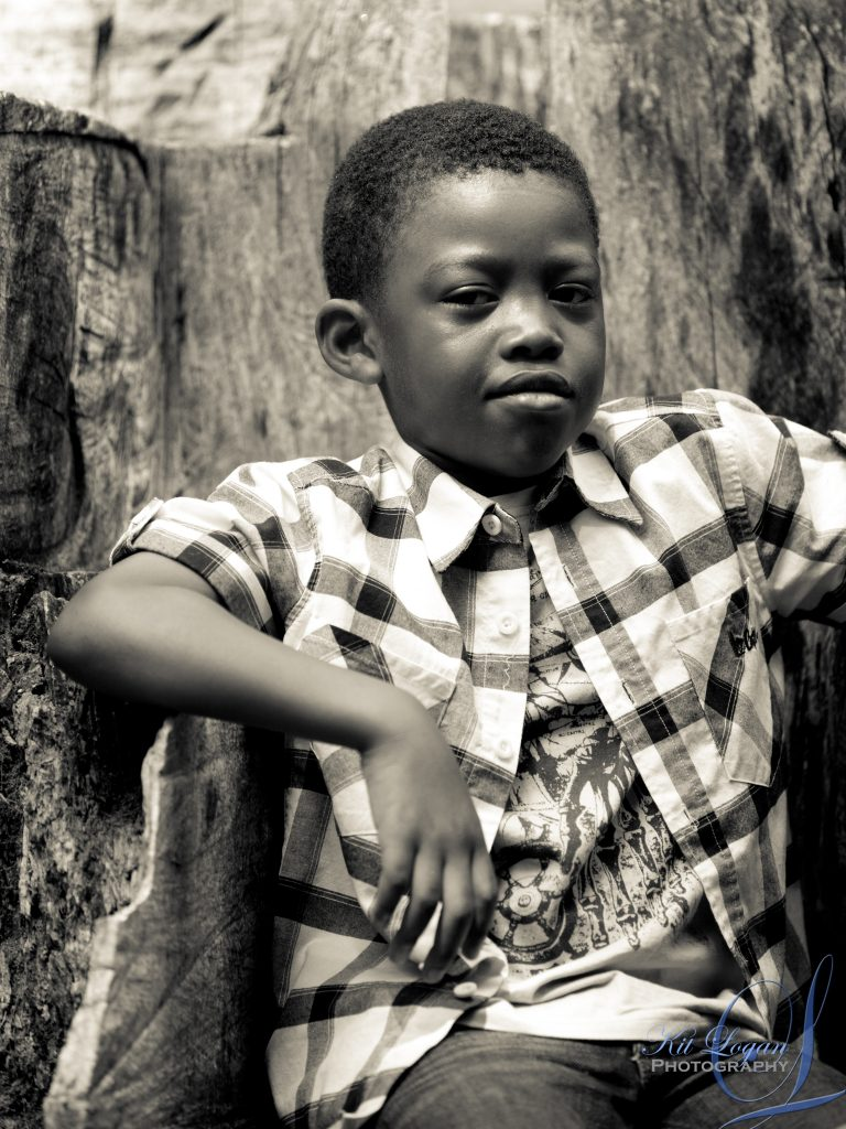 Black and white portrait of young dark skinned boy