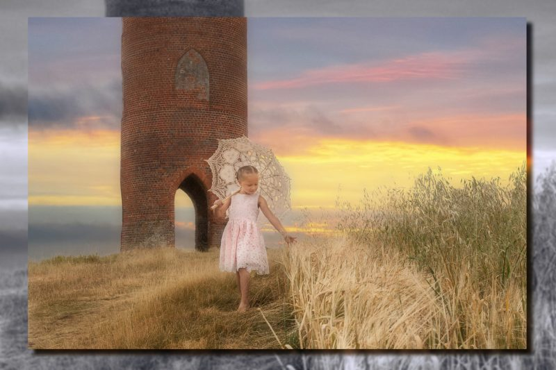 Young girl with parasol walking touching the corn