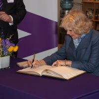 HRH Duchess of Cornwall signing the guest book