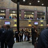 crowds looking on from the internal windows