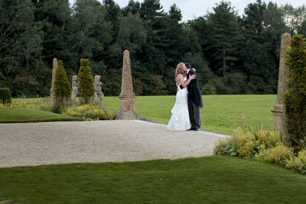 bride and groom in formal garden