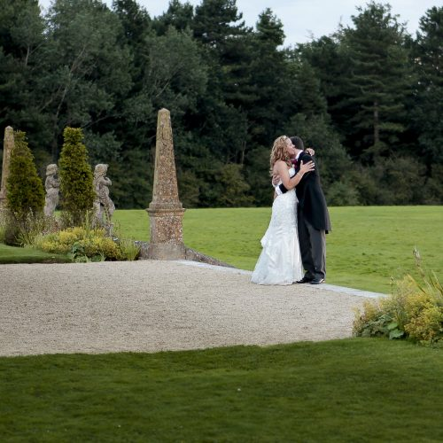bride and groom in formal garden