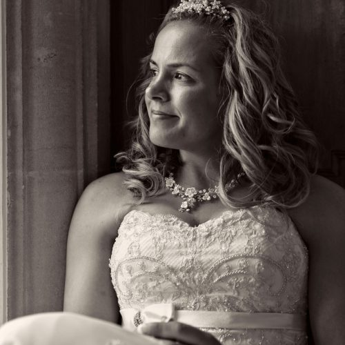 bride portrait sitting at window