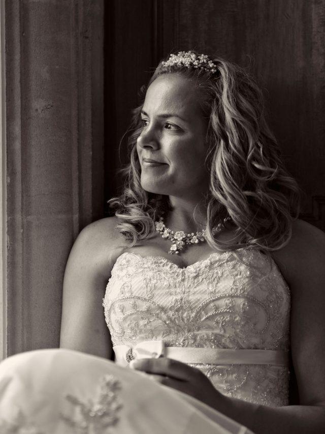 bride portrait sitting at window