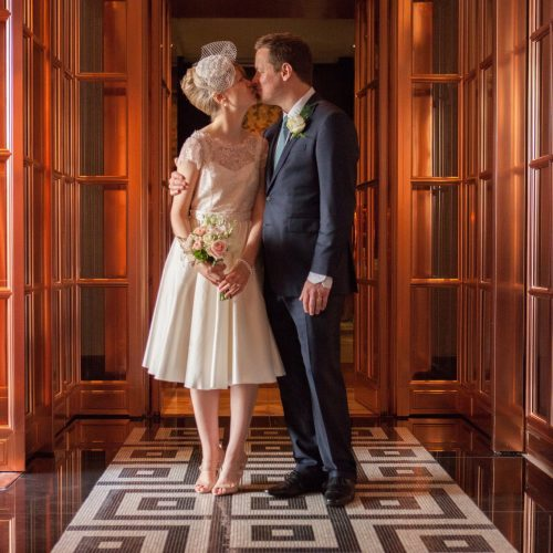bride and groom in art deco hall