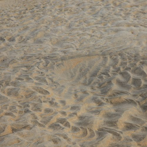 water ripples in sand pattern