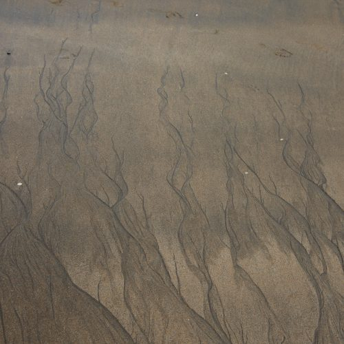 patterns in sand left by water