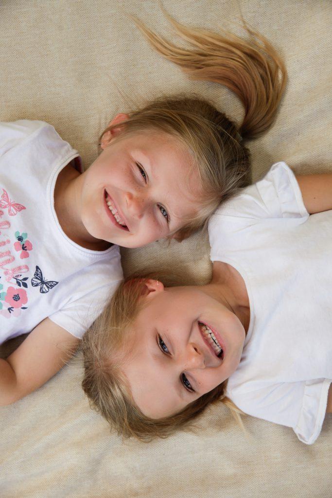 Portrait of identical twin girls